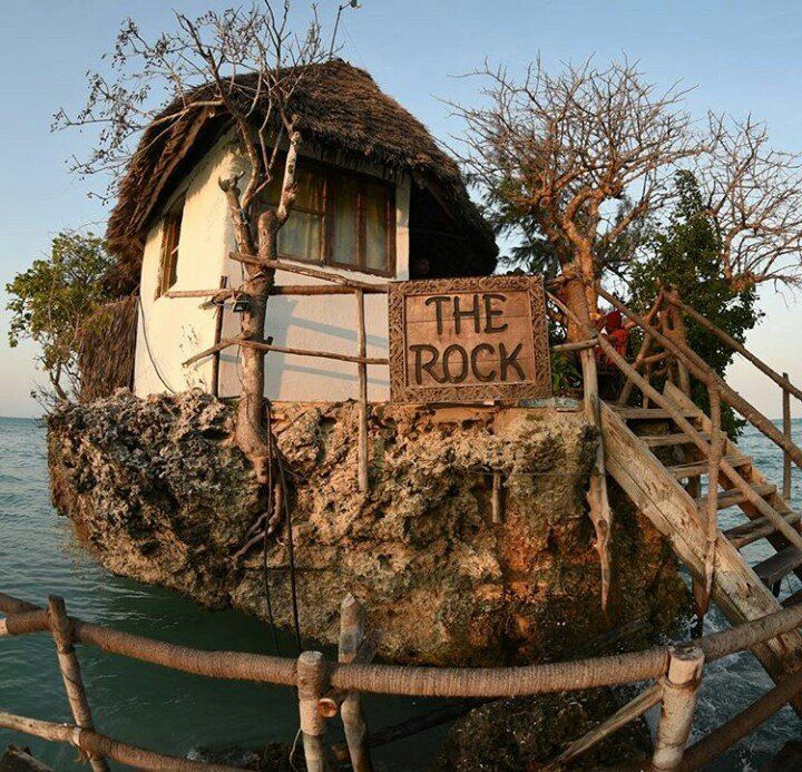 The Rock is a restaurant. Located in a unique position on a rock in the middle of the Indian Ocean, The Rock Restaurant is a charming exclusive restaurant that in a very short time has become one of the icons of the island. The Rock has been founded in July 2010 by a group of partners. One of them is also founder and partner of Kichanga Lodge and Dongwe Ocean view, respectively a lodge and a boutique hotel in Zanzibar.The Rock was originally a fisherman post, and is located in the middle of…