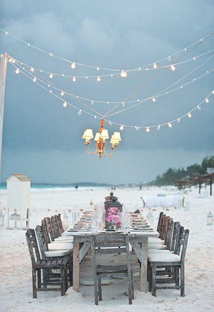 A gorgeously light table on the beach.