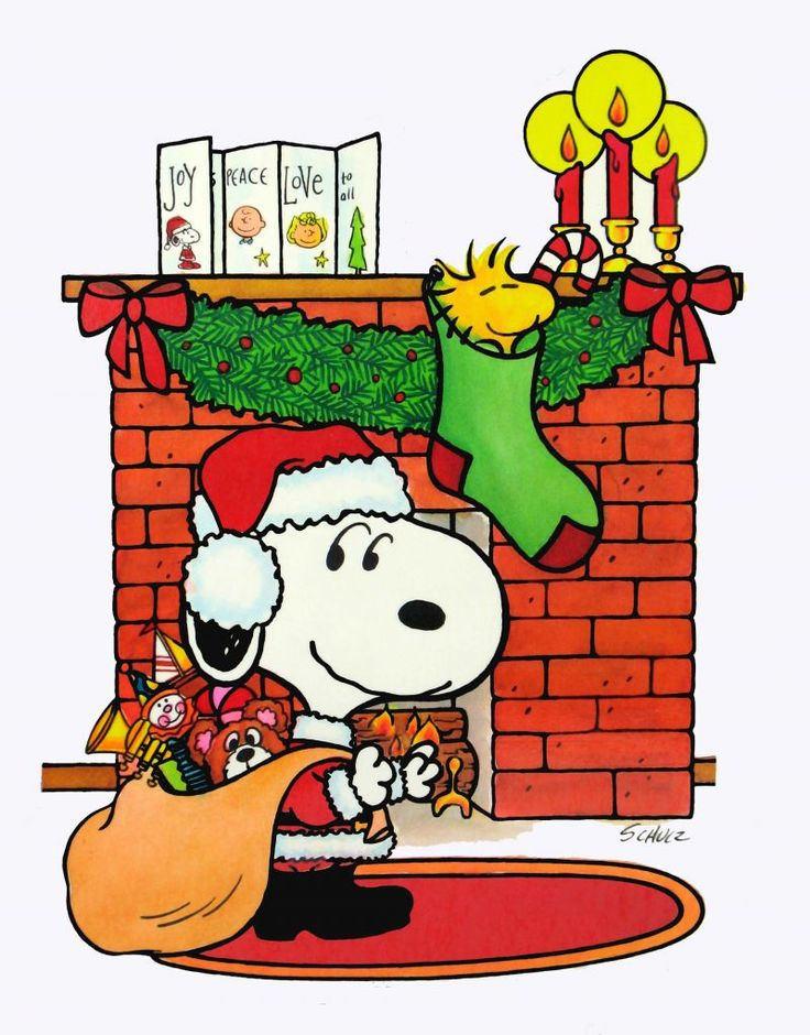 Santa Snoopy with his bag full of presents & Woodstock hanging up in the Christmas stocking.