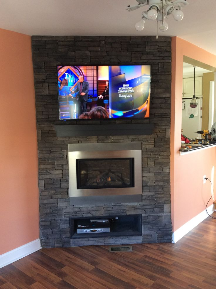 -Built and Stoned Corner Wall -Installed Valor H4 Fireplace -Painted and Installed Premier Mantel Shelf -Installed and Hung TV -Setup Cable Box and DVD Player -Installed New Flooring -Completed Baseboard to the New Fireplace Wall