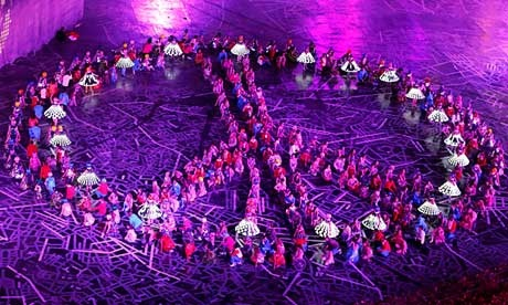 Performers take part in the opening ceremony of the London 2012 Olympic Games at the Olympic Stadium - Young performers arrange themselves into a peace sign. Photograph: Fabrizio Bensch/Reuters