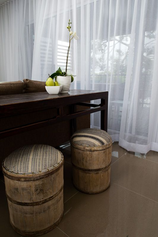 To get a multi purpose dining and work space in a very compact unit I've combined an antique Chinese alter with repurposed vintage wine barrels from France.