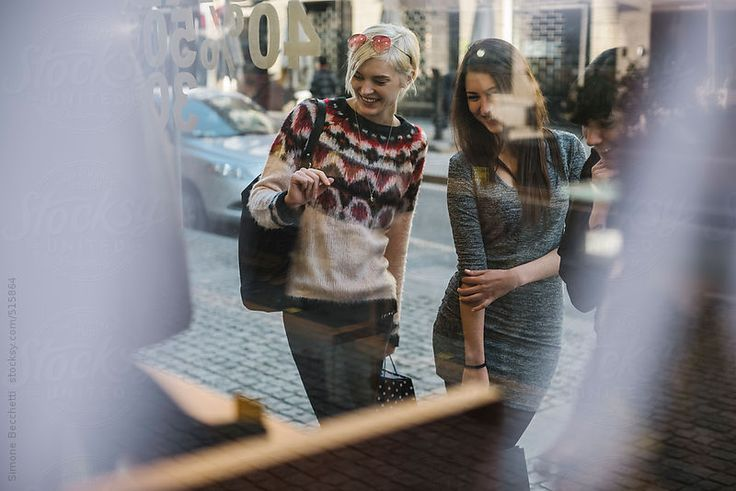 Three young women during shopping in the city.