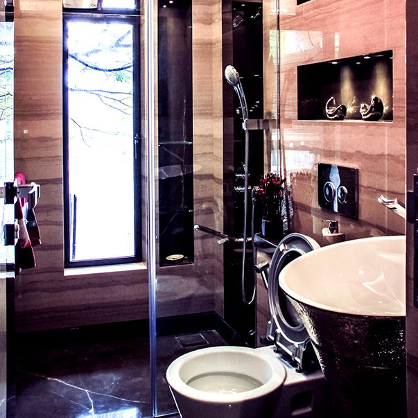 Extravagant bathroom with a big tub and a shower. Elegance provides you a great place to relax!