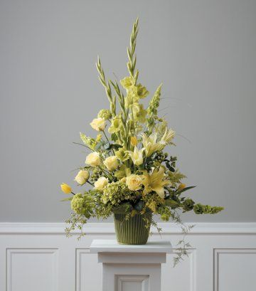 Idea for alter flowers - maybe in gold vases with somehow tying in Mom's original flowers