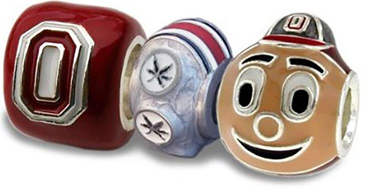 OSU Buckeyes 3-D Charms- Set of 3 - 1 Scarlet Block O + 1 Brutus + 1 6-Leaf Bead. Officially licensed through Ohio State University. These are silver plated, hand colored beads, 100% made in the USA. The Ohio State mascot Brutus bead charm is a perfect piece of college jewelry for any bracelet or necklace. These OSU Bead Charms will fit Pandora bracelets and necklaces, Chamilia, Biagi, Troll. These unique Ohio State charm beads can be arranged to make an exciting necklace, bracelet or…