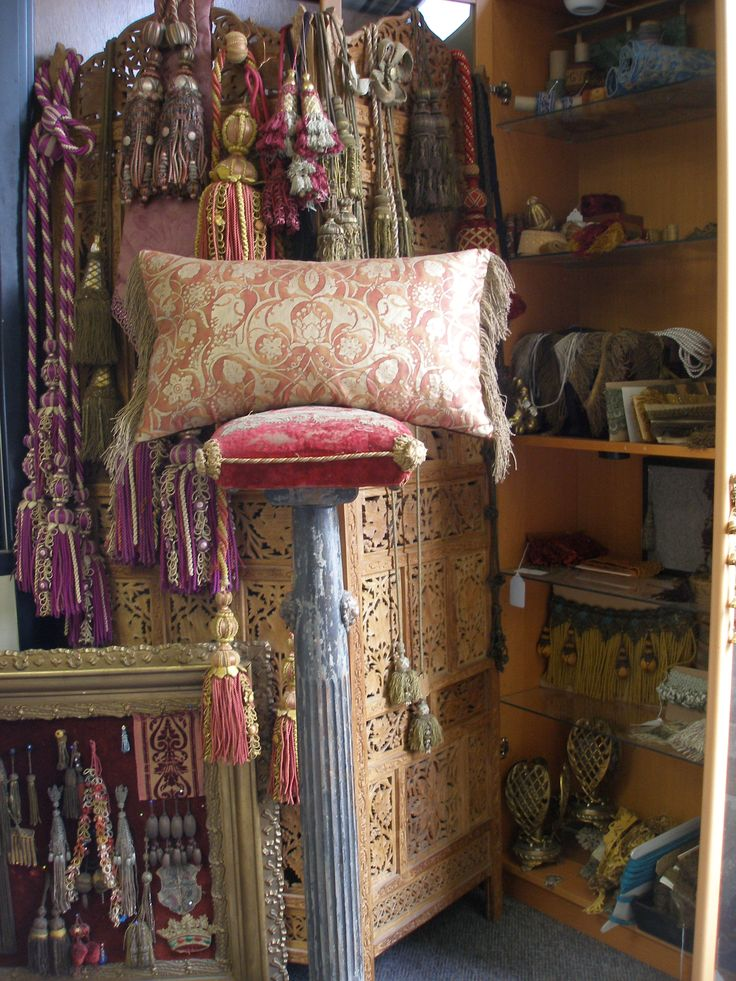 Gorgeous workroom with tassels for pillow making.