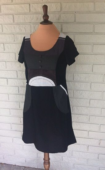 Made by Anne-Britt Nygaard. Facebook: 2sisters redesign.  Different kind of black materials comined with a touch of grey give this dress a beautiful look. Size 38 http://epla.no/handlaget/produkter/726525/