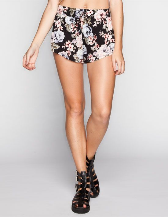 Volcom Noir woven pull on shorts. Allover floral print with small Metal  Volcom logo badge at front of waist. Elastic waistband with drawstring.