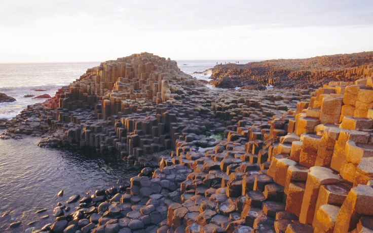 The giant's causeway, Northern Ireland - 60 million years ago a huge volcanic eruption spewed out a mass of molten basalt, which then solidified and contracted as it cooled, creating the cracks that can be seen today. 20 Serious Weird Places | 20 Seriously Strange Places | Rough Guides