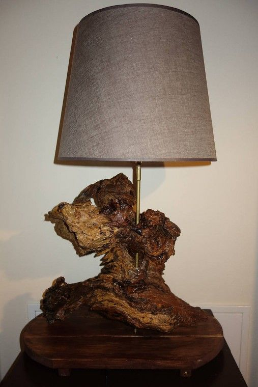 Lamp made from an old wood piece found in a forest.