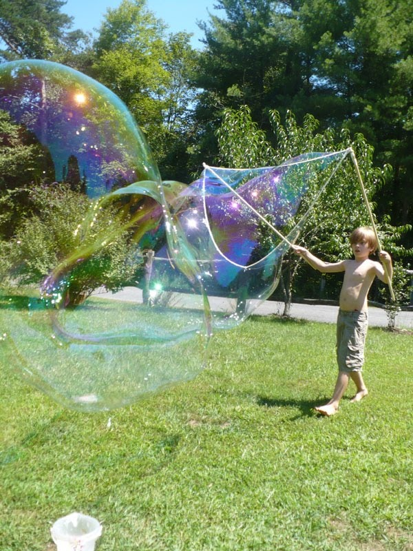 giant bubbles (homemade wand) by The Enchanted Tree!