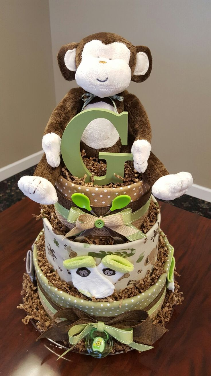 Jungle monkey diaper cake. Baby boy shower gift/ centerpiece. More photos on Facebook page Simply Showers.  https://m.facebook.com/adorablegifts