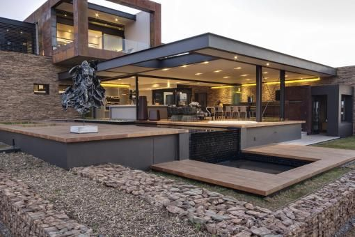 a spacious and luxurious four bedroom steel , glass and concrete residence with an emphasis placed on the design of the living rooms.