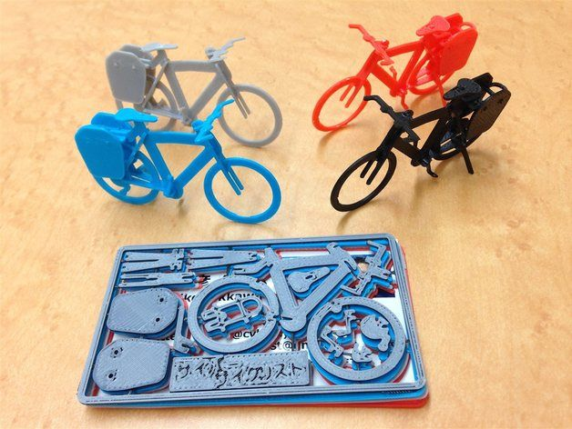 "Business card with touring bike plastic model, japanese size(a bit larger than U.S. card). Small plate for your name. Optimized for FDM printer with 0.4mm nozzle. It's better to fix parts with instant glue in each assemble steps.   Inspired by Velociraptor Business Card http://www.thingiverse.com/thing:362357 .   If you only want to build the model, download ""without_gates"" file. Building steps are shown in Gallery.   Printer: AFINIA H480 Filament: ABS Modeler: Autodesk 123D Design Slicer…"