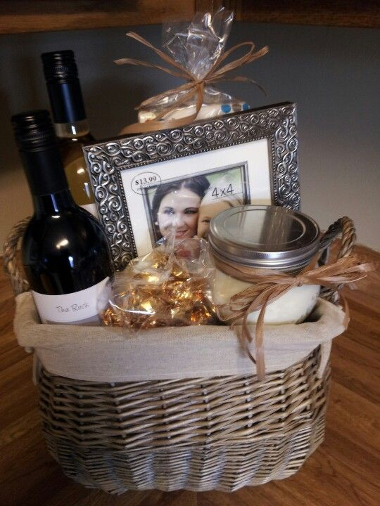 Sympathy gift basket. 2 bottles of wine for sharing with family, tissues, a candle, dark chocolate truffles, and a picture frame to frame a pic of your lost loved one.