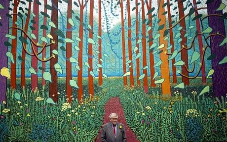 David Hockney standing in front of his work: The Arrival of Spring in Woldgate, East Yorkshire, 2012