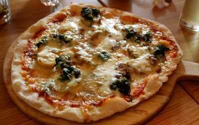 TRY : For a quick party appetizer, spread pizza base with tomato sauce and top with crumbled blue cheese, olives and whole basil leaves.