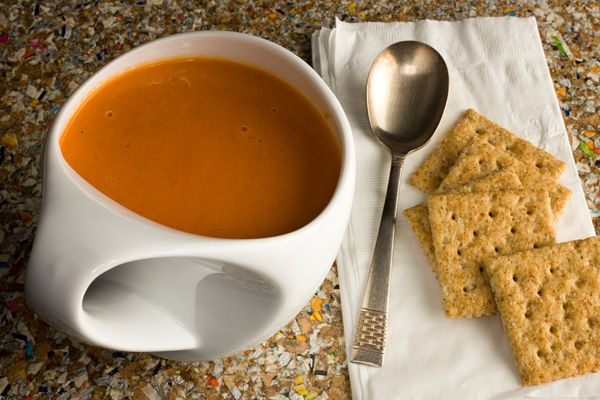 Creamy Tomato Soup - It's missing something sweet to cut the acidity of the tomatoes, so I added 2 grated carrots and a handful of grape tomatoes when I added the canned tomatoes, and it worked great.