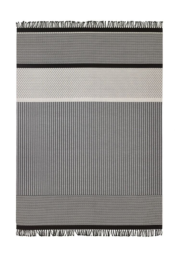 Woodnotes San Francisco paper yarn carpet col. light grey-stone. The San Francisco carpet's design is an asymmetrical combination of different vertical and horizontal stripes and squares. Design by Ritva Puotila
