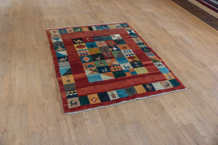 Hand Knotted Gabbeh Rug from Iran (Persian). Length: 173.0cm by Width: 143.0cm. Only £953 at https://www.olneyrugs.co.uk/shop/rugs-for-sale/persian-gabbeh-21858.html    Olge our gorgeous display of oriental carpets, kilim ottomans and Kilim cushion covers at www.olneyrugs.co.uk