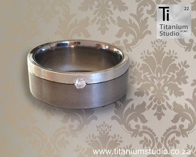 Titanium base ring with silver inlay and diamond.