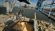 (Amy Davis, Baltimore Sun / April 10, 2012 )  The Simon Schulte, a cargo ship from Guatemala arrived at the Domino Sugar refinery in Baltimore's Inner Harbor this morning, and two cranes began unloading its 95.5 million pounds of raw sugar. This is the largest shipment of sugar to arrive at Domino, which will be celebrating its 90th birthday in Baltimore this May.