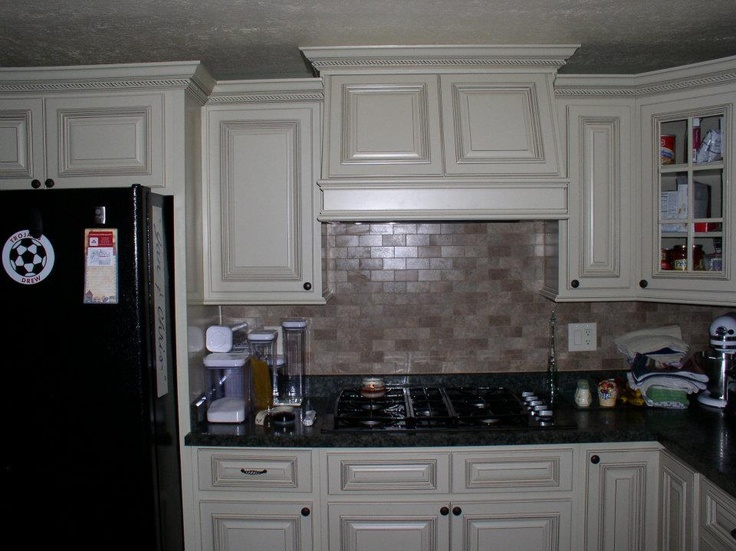 arlington white kitchen cabinets with wooden range hood