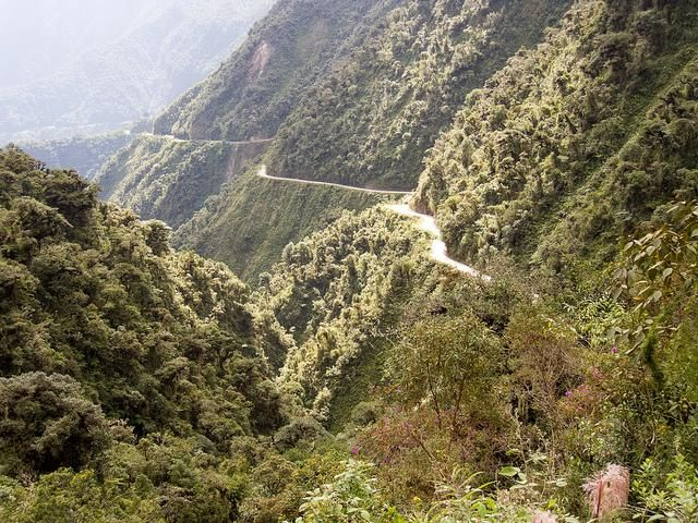 """Yungas Road – Bolivia. With no barriers and literally nothing stopping you from plummeting a long (long) way down, it has been deemed the most dangerous road in the world and has even been given the name """"Death Road"""". One estimate is that 200 to 300 people are killed yearly along the road."""