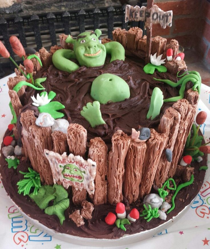 Flakes on the outside of a Swamp Cake. Need a gator instead of Shrek though.