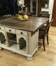 Old side table turned into kitchen island with seating