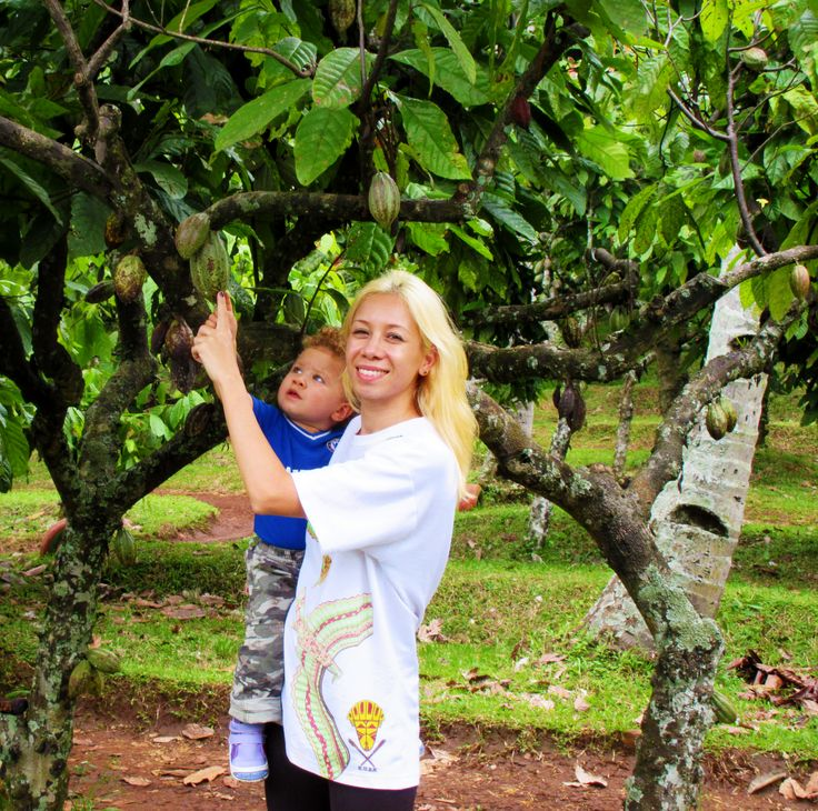 Mother-Daughter checking out a Chocolate Tree in Indonesia :)