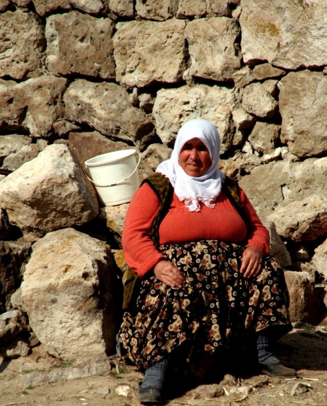 A woman wearing traditional Turkish Salvars, or baggy pants