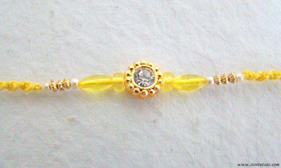 e38b90443758810aaa911c1e0933f137 rakhi handicraft - Rakhi Handmade Yellow Wrist Band Sibling Bands by StoreUtsav