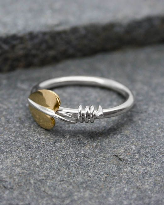 Handmade silver and brass leaf ring.  The brass leaf has silver wire vine tendrils wrapped around a simple silver band.  Also available with a copper leaf.  #brass #handmade #leaf #ring #silver #starboardjewellery #jewellery #cornwall #uk #gb #westcountry #devon #england #silversmith #pretty #jeweller #jewellers #handmadejewellery