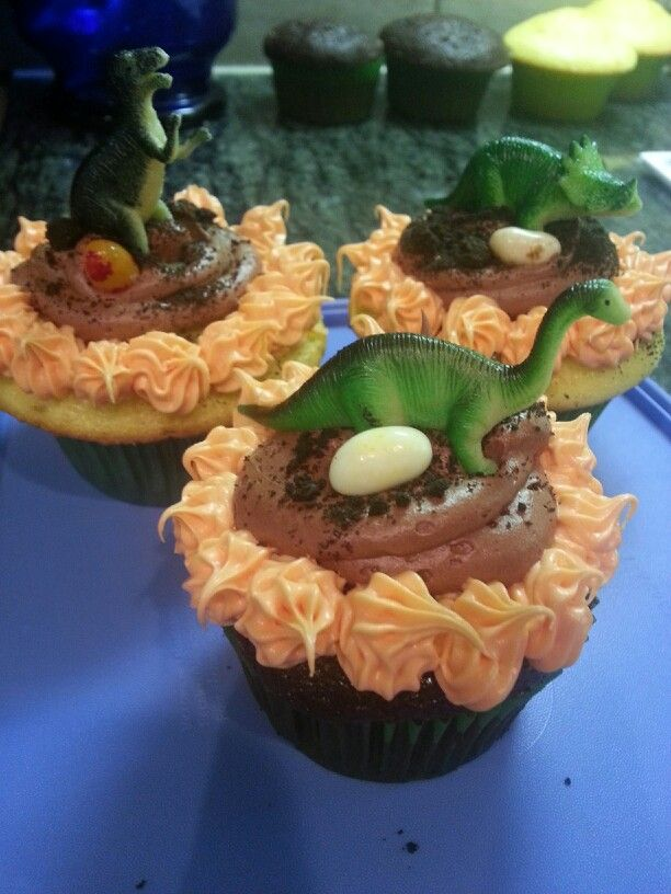 Dino cupcakes Dinosaur cupcakes so fun,  Oreo crumbles represent dirt on top and jelly belly as Dino eggs the toy Dino on top from party city kids loved them