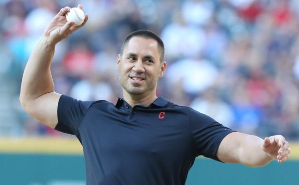 Former Cleveland Indians player Travis Hafner throws out the ceremonial first pitcher before the Indians game against the Detroit Tigers, July 8, 2017, at Progressive Field.