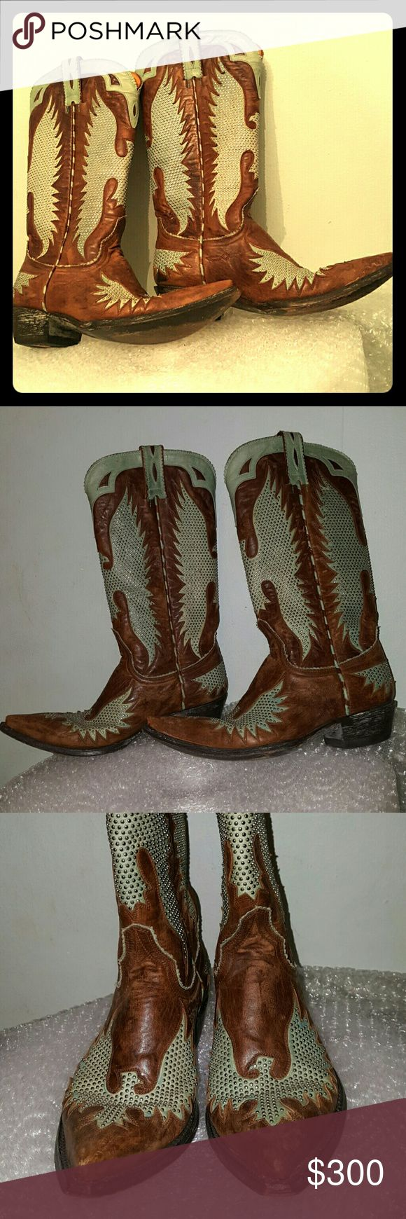 "Old Gringo 1276-4 SS Iron Eagle 6.5 B aqua western Made in Leon, Mexico. Distinctive Old Gringo's Eagle design. Goat leather with aqua underlay and overlays. Myriad of silver studs on aqua underlay. 1 3/4 "" Cuban heel. Leather soles. Tan leather lining. Left boot has a small scub at the toe. Moderate wear to the heel & sole. Sold out style. Some light blue staying on aqua parts. Old Gringo Shoes Heeled Boots"