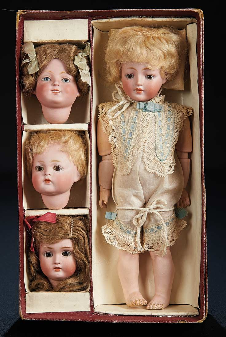 """Marks: 178. Comments: Kestner,circa 1910. Value Points: the doll is presented,unplayed with,in her original box labeled """"Kestner Character Doll"""",along with three additional bisque heads designed to be interchangeable,each with original soft mohair wig in various style,including models 174,184,and 185,all in superb origina"""