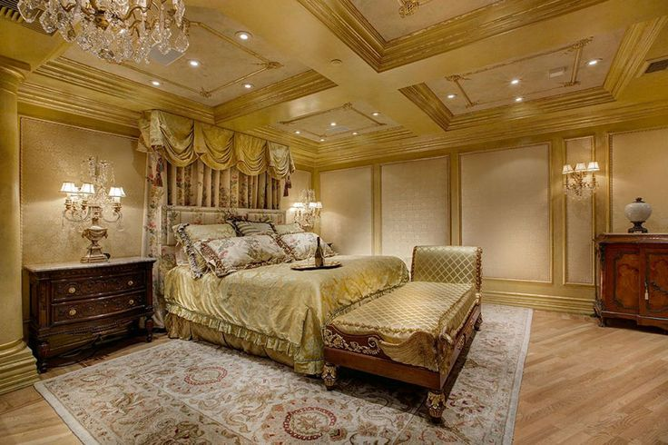 Luxury bedroom with baroque style, light wood floors and box ceiling