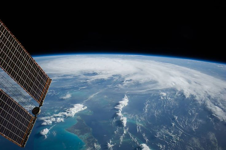 As the International Space Station was flying 227 nautical miles above the Bahama Islands, one of the Expedition 40 crew members photographed this image of Hurricane Arthur, moving northerly along the Atlantic coast line. Arthur's forecast at 11 a.m. (EDT) on July 3, 2014 projected it hitting the coast of North Carolina as a Category 2 hurricane, with winds over 100 mph, on the night of July 3 or the morning of July 4. A tip of one of the solar panels on the orbital outpost is in upper left.
