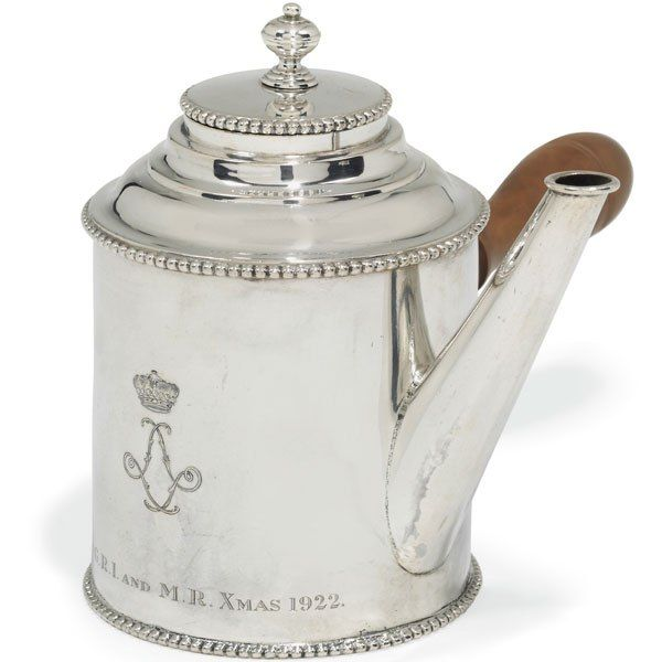 This circa-1919 Danish silver hot-water pitcher was a Christmas present to Mary's husband, Henry Lascelles, the sixth Earl of Harewood, from his parents-in-law, King George V and Queen Mary. The teatime essential bears a coroneted monogram—the interlaced L's refer to Harewood's title at the time, Viscount Lascelles—and the inscription G.R.I. and M.R. XMAS 1922. Estimate: $800–$1,120