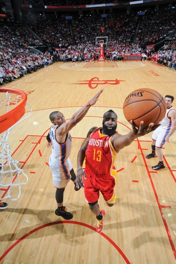 FEBRUARY 20: James Harden #13 of the Houston Rockets shoots a layup against Russell Westbrook #0
