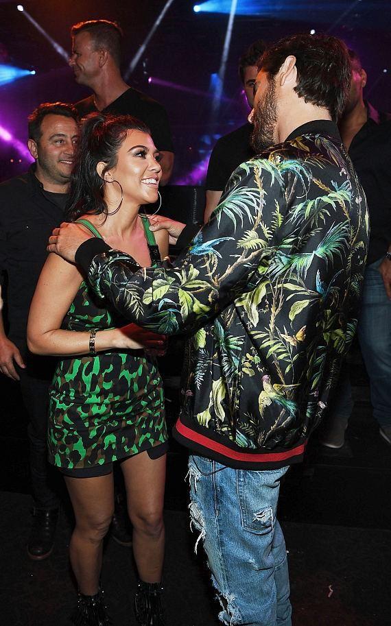 Scott Disick & Kourtney Kardashian at 1 OAK Nightclub (Photo credit: Denise Truscello / WireImage).