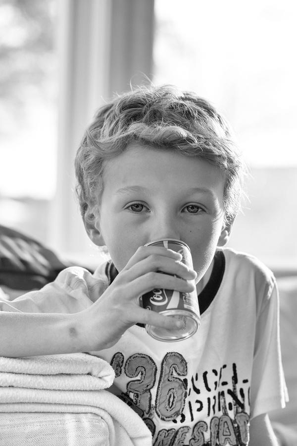 Boy drinking a soft drink