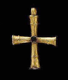 A BYZANTINE GOLD AND GARNET CROSS                                                                                                                                                                       CIRCA 5TH CENTURY A.D