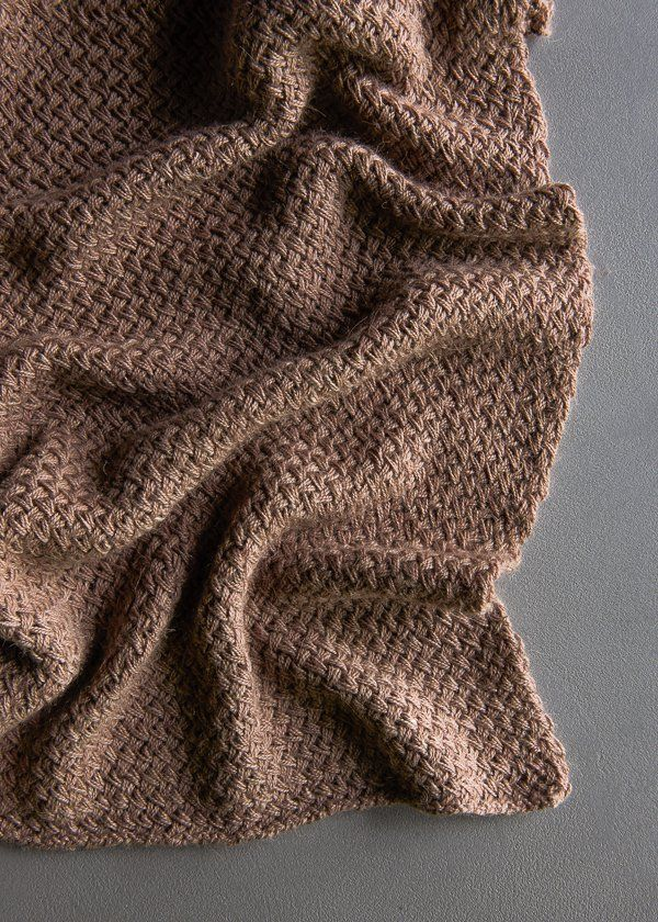 create a fabric that so closely resembles a woven basket or a plaited braid
