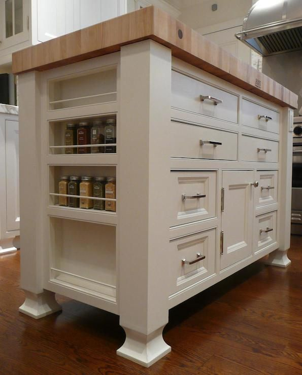 Freestanding White Kitchen Island With Built In Spice Racks And Inset Cabinet Fronts Accented With
