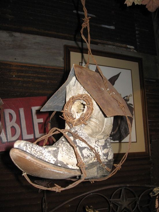 Boot Birdhouse.  Ha, My son left his old boots when home at Christmas.... Mom has ideas :-)