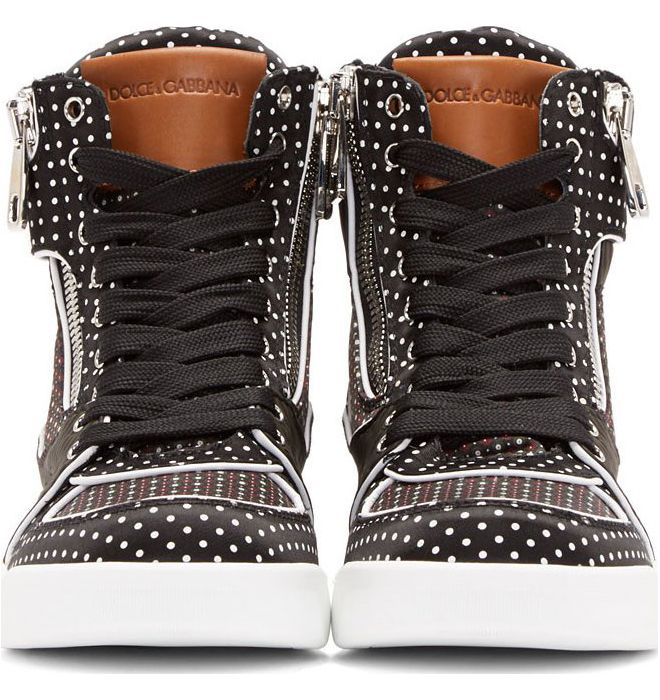 Black and Grey Contrast Print High Top Sneakers by Dolce & Gabbana. High top textile and leather sneakers in black. Contrasting print panels in black and white polka-dot, dark green and purple check, and black and grey stripes, at exterior. Silver-tone zippers, eyelets, and printed velcro straps at vamp. Piping in white. Logo patch in brown leather at tongue. Lining in black leather. Raised tab at heel collar. Contrast rubber sole in white.  http://zocko.it/LD2tO